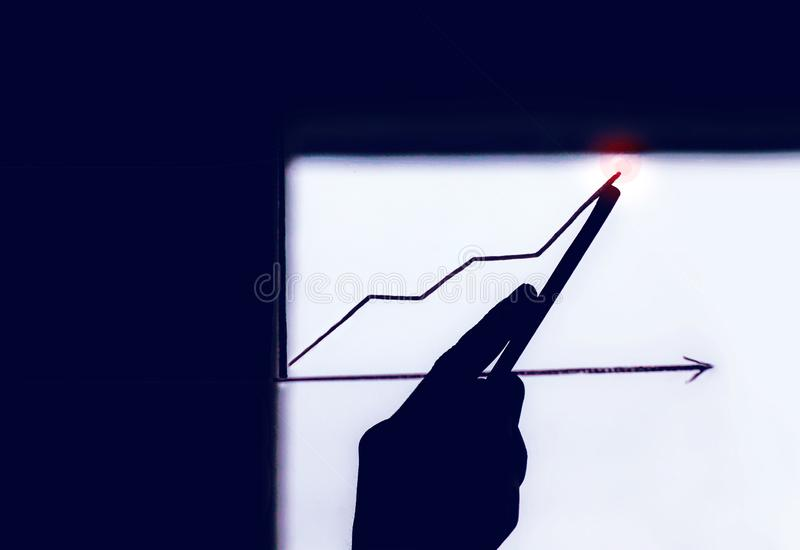 Male hand drawing a graph. Business development to success and growing growth concept, Businessman pointing arrow graph corporate. Business development to stock photo