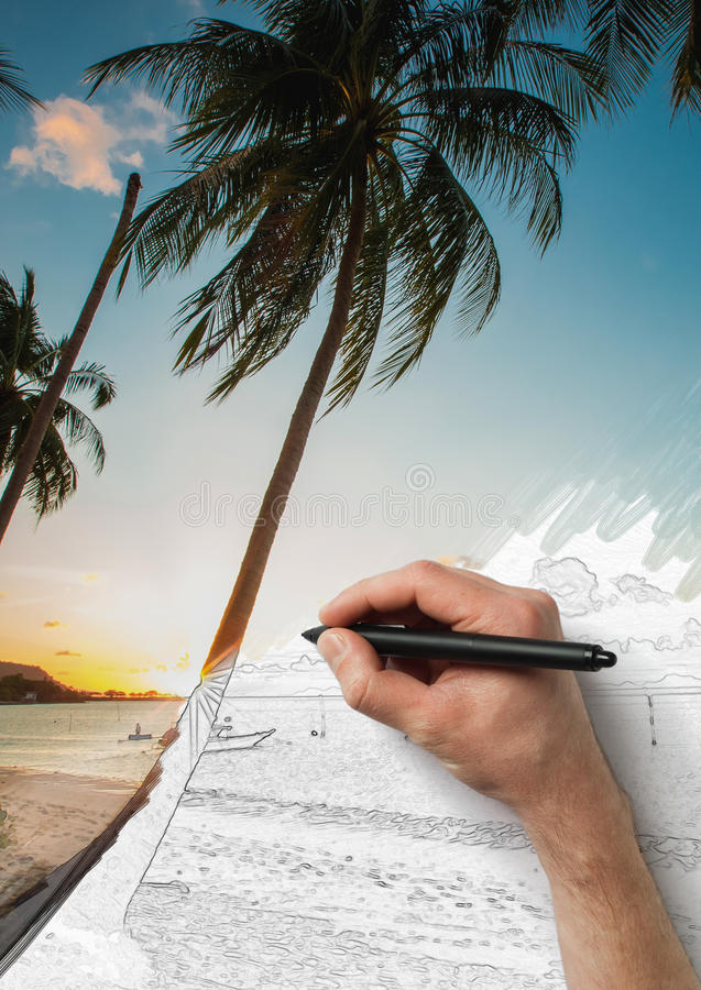 The male hand drawing picture from photo with a pen royalty free stock images