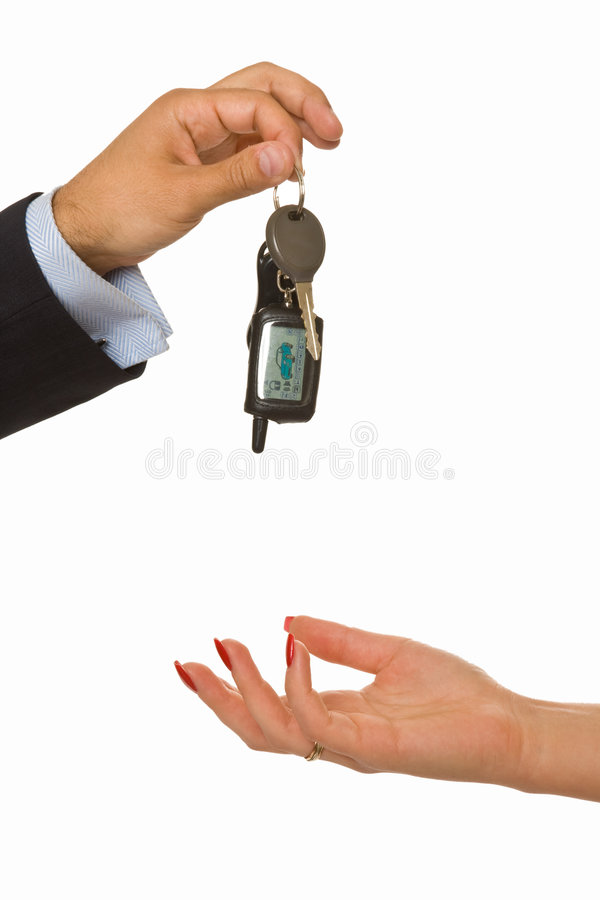 Male hand drops a bunch of car keys. A male hand drops a bunch of car keys into a female hand stock photos