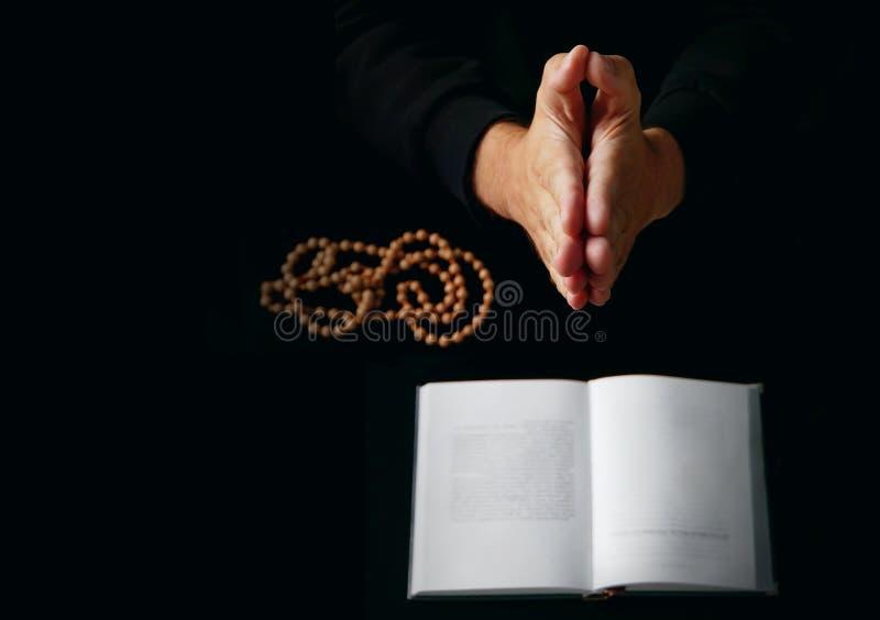 Male hand folded in prayer stock image