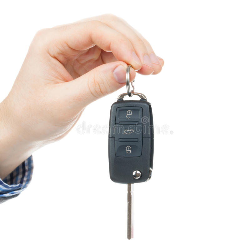 Male hand giving car keys - close up. Shot stock photo