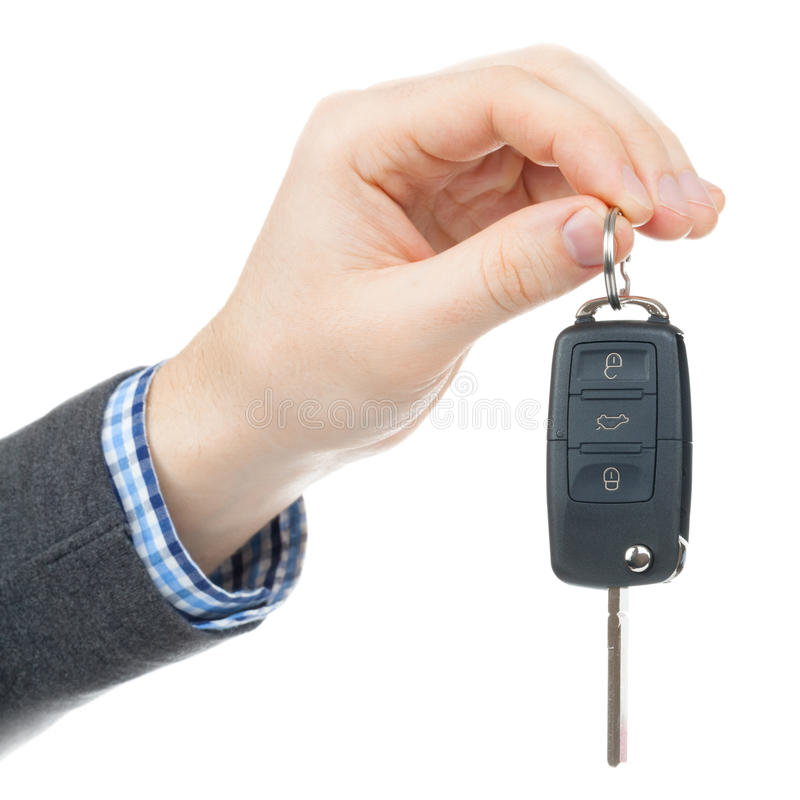 Male hand giving car keys - studio shot. Isolated on white background royalty free stock images