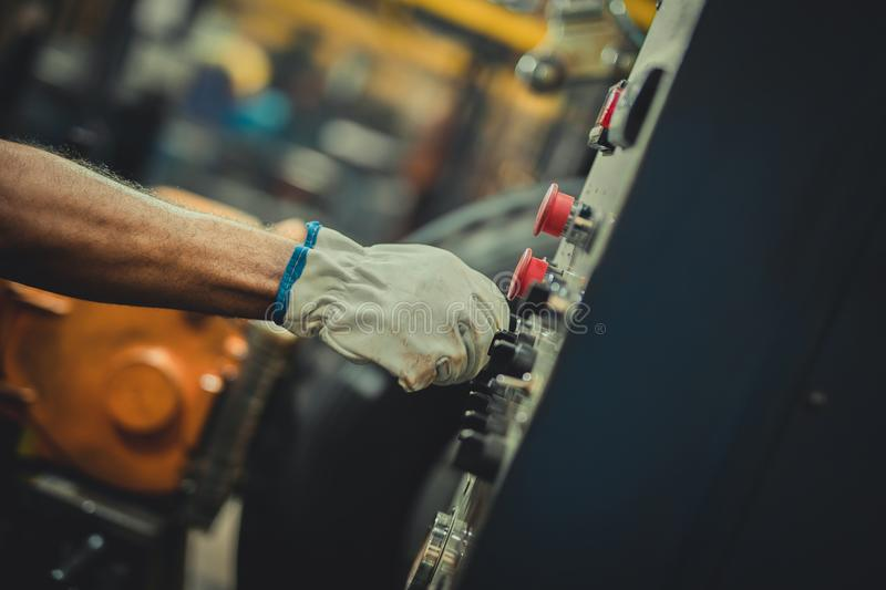 Male hand with gloves pushing button stock photos