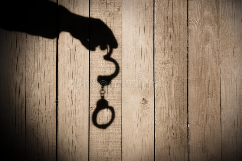 Download Male Hand With Handcuffs On Natural Wood Background, XXXL. Stock Photo - Image of officer, legal: 39528406