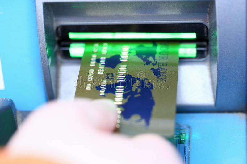 Male hand hold bank plastic card aganist atm royalty free stock photos