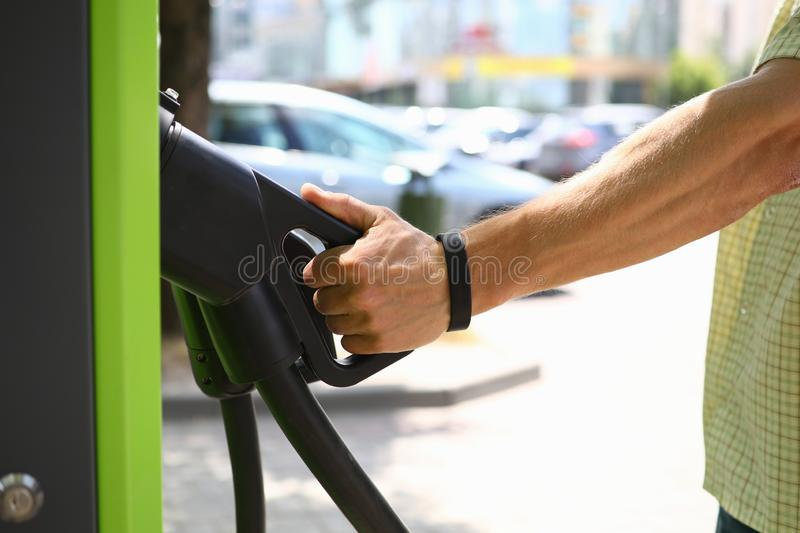 Male hand hold pistol an electric charge royalty free stock images
