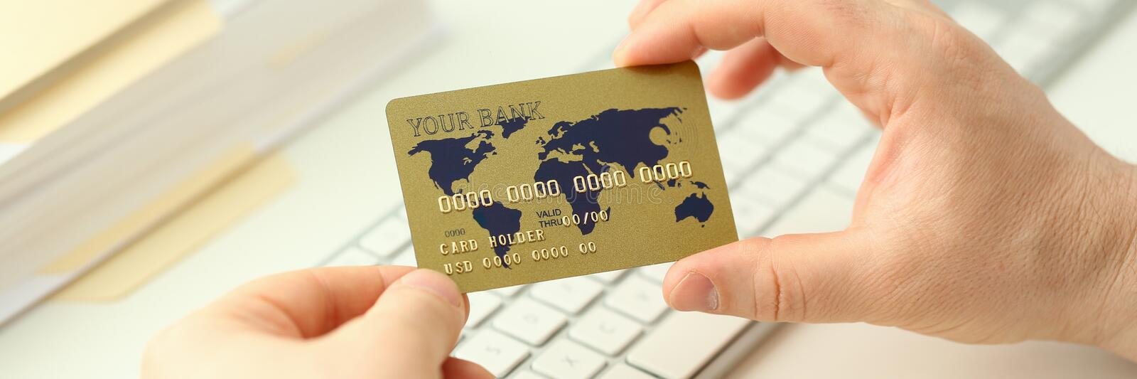 Male hand hold plastic bank card aganist royalty free stock photography