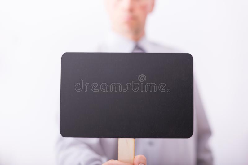 Male hand hold small black chalkboard royalty free stock images