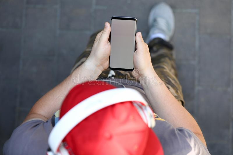 Male hand hold smartphone with blank royalty free stock photos