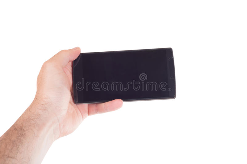 Male hand holding a blank black mobile phone stock photography