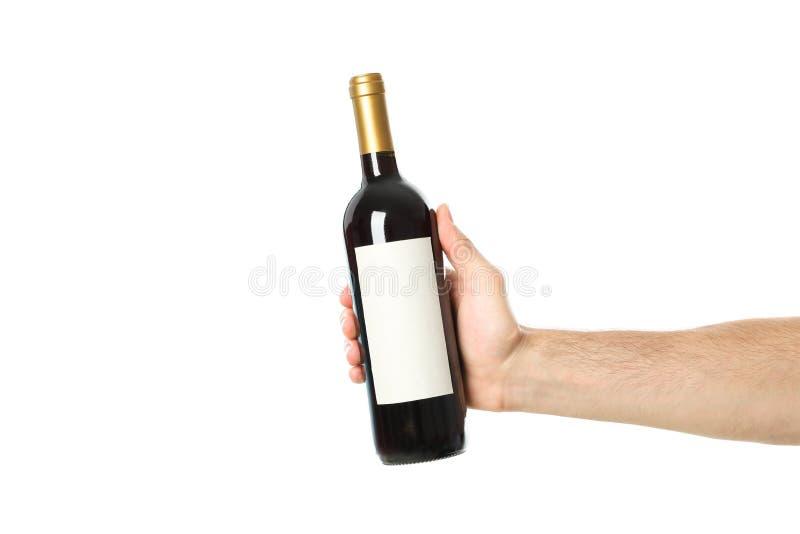 Male hand holding bottle of wine,. On white background stock image