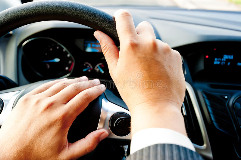 Male hand holding a car wheel stock photography