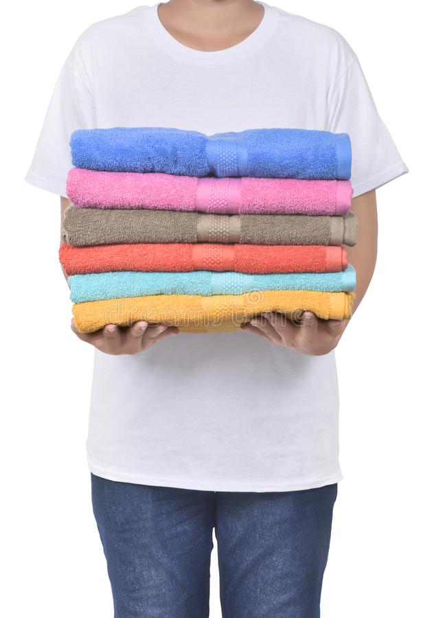Male hand holding colorful towels pile. Isolated over white background royalty free stock image