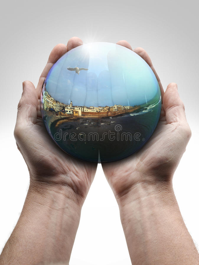 Male hand holding a crystal ball royalty free stock photos