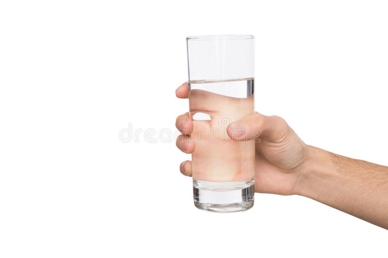 Male hand holding glass of water isolated on white royalty free stock photography