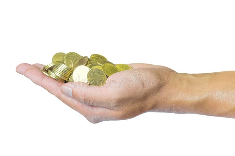 Male hand holding golden coins. Saving, money, finance donation, giving and bussiness concept. Isolated on white background with royalty free stock photos