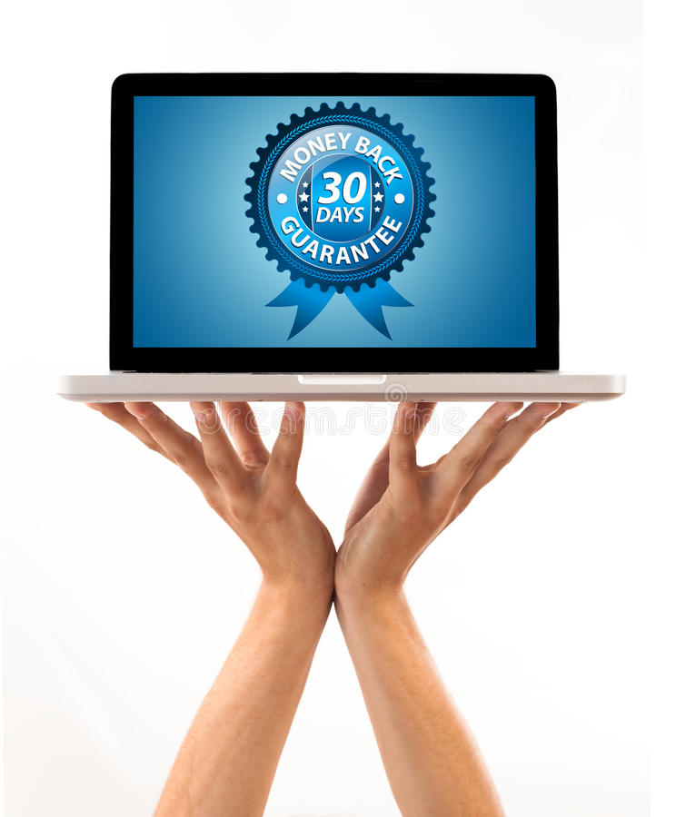 Download Male Hand Holding A Laptop With Money Back Label Stock Image - Image: 16242571