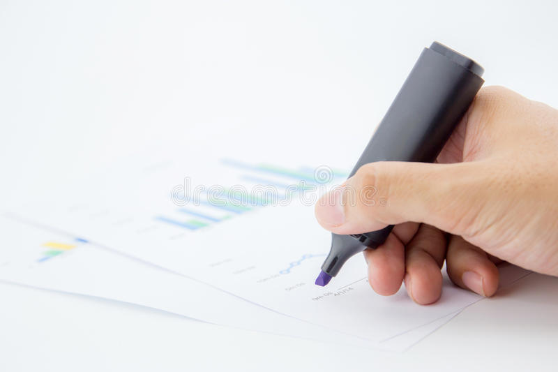 male hand holding marker over business document. royalty free stock photo