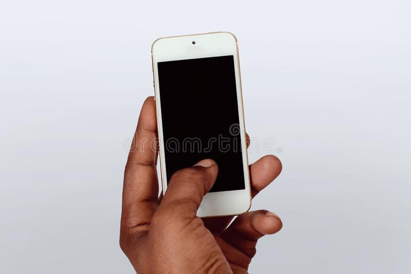 Male hand holding smartphone with blank screen royalty free stock image