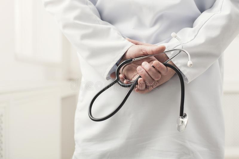 Male hand holding stethoscope closeup stock images