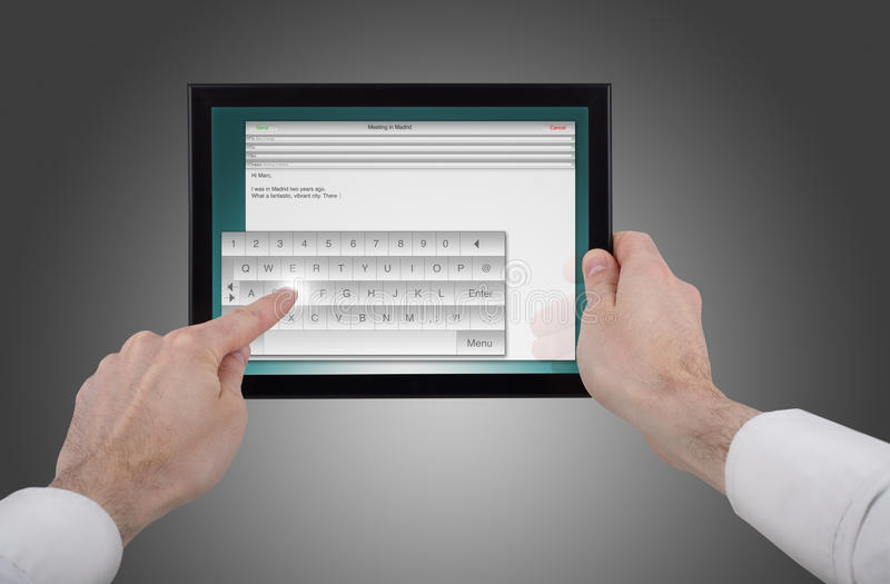 Download Male Hand Holding A Touchpad Pc Writing An E-mail Stock Photos - Image: 14009063