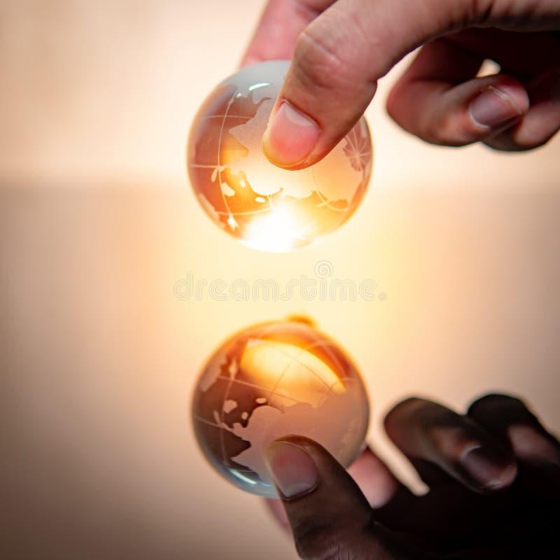 Male hand holding world globe crystal glass stock photos