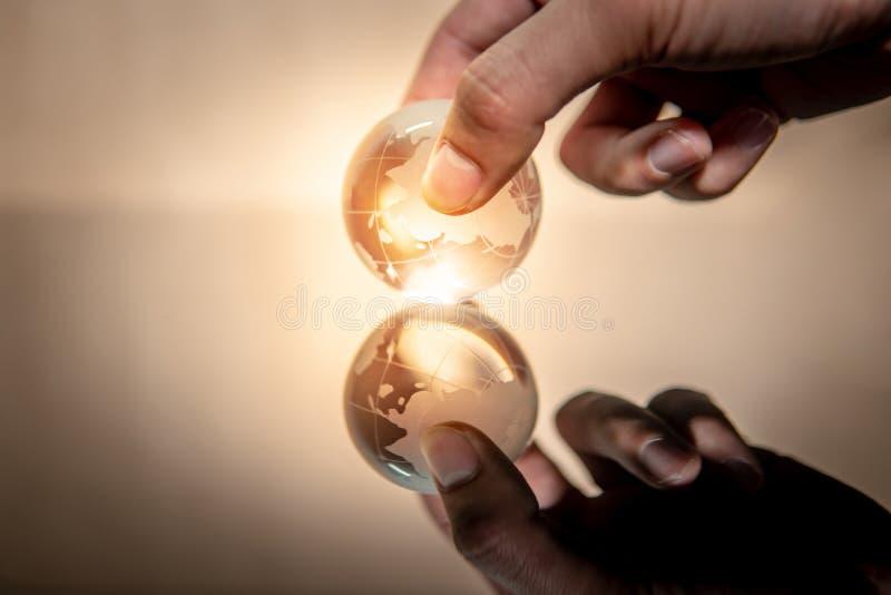 Male hand holding world globe crystal glass royalty free stock photo