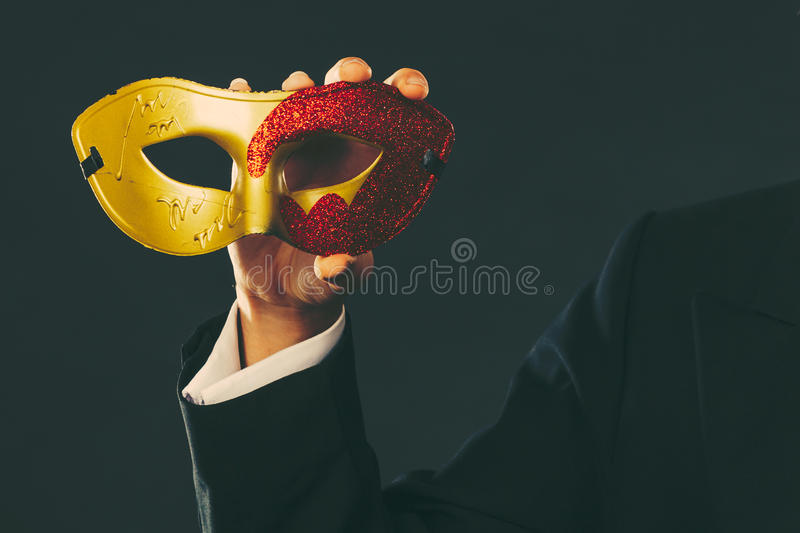 Male hand holds carnival mask closeup royalty free stock images