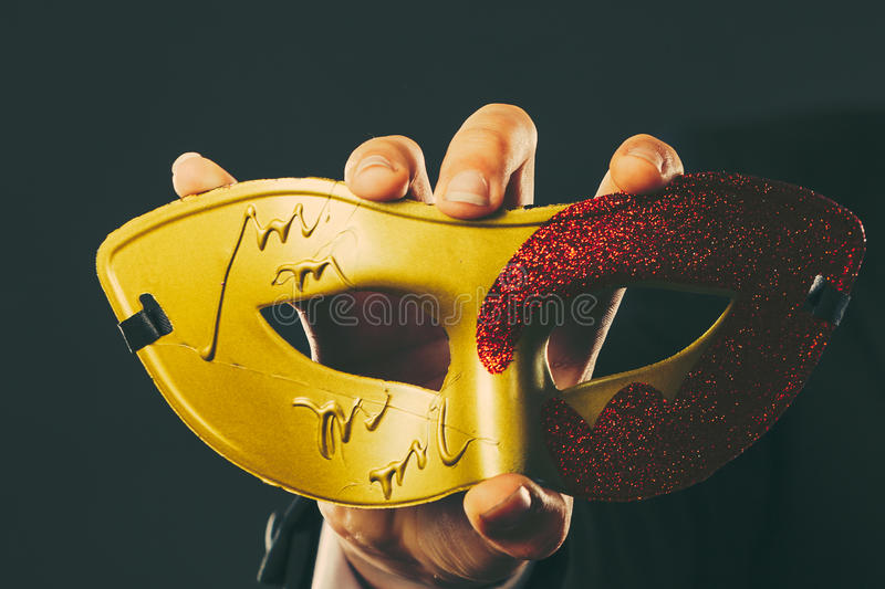 Download Male Hand Holds Carnival Mask Closeup Stock Photo - Image: 83715623
