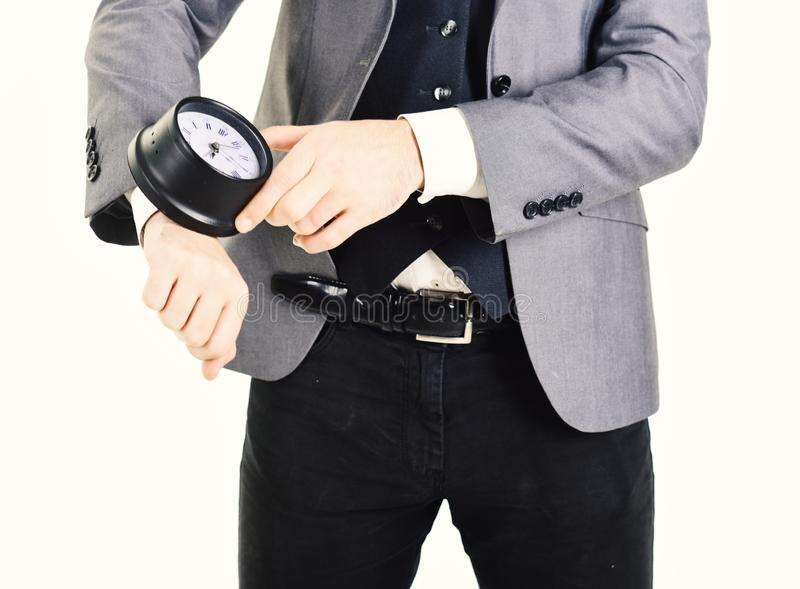 Male hand holds stopwatch. Man wears elegant suit with stopwatch royalty free stock images