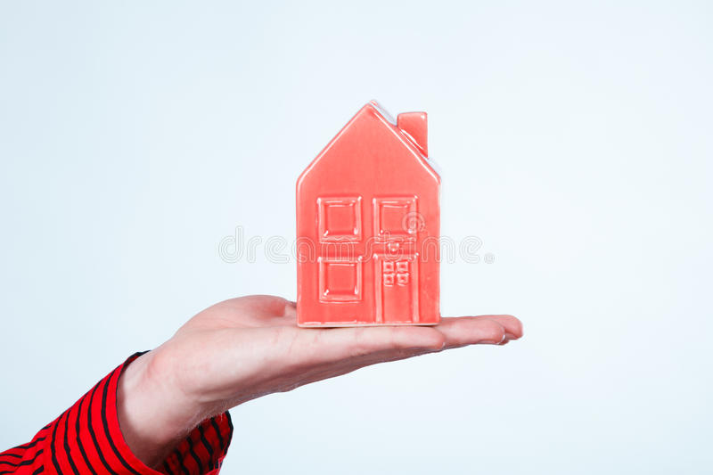 Male hand with little red house. royalty free stock photo