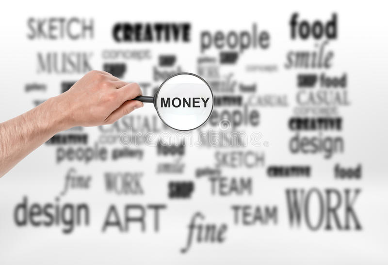 Male hand with magnifying glass and word 'money' in it over collage of terms royalty free stock image