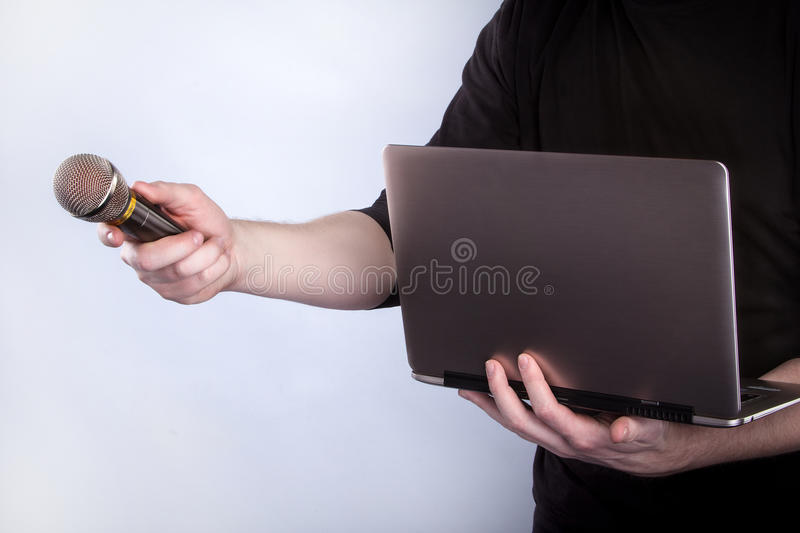 Male Hand With Microphone And Notebook Royalty Free Stock Photos