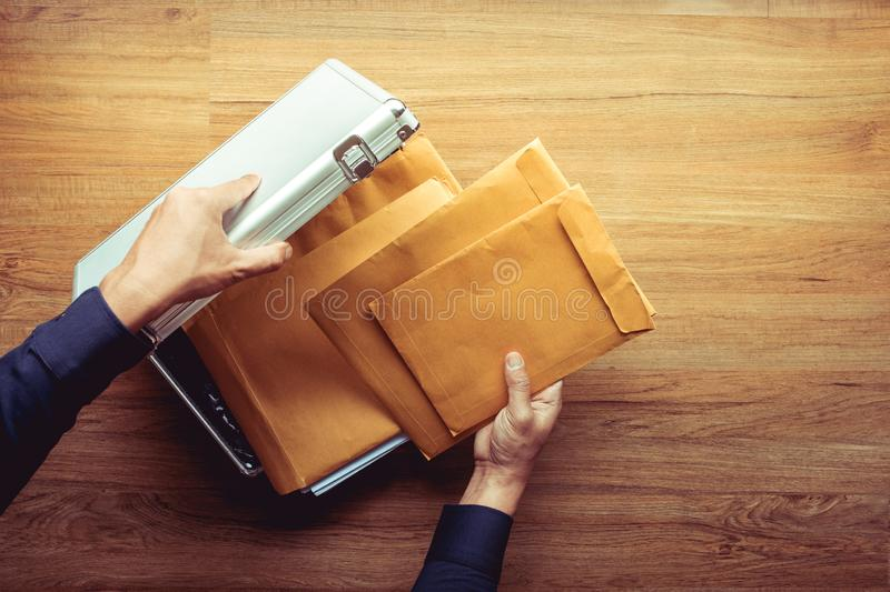 Male hand open safety box metal and Important document paper inside.Business management.security concepts. Ideas stock photos