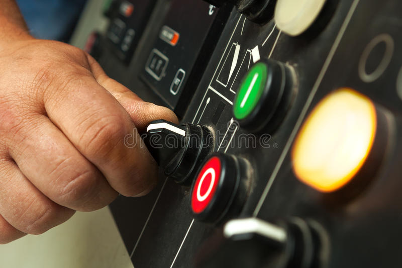 Male hand operating switches and buttons. Male hand operating switches and buttons on control panel royalty free stock photography