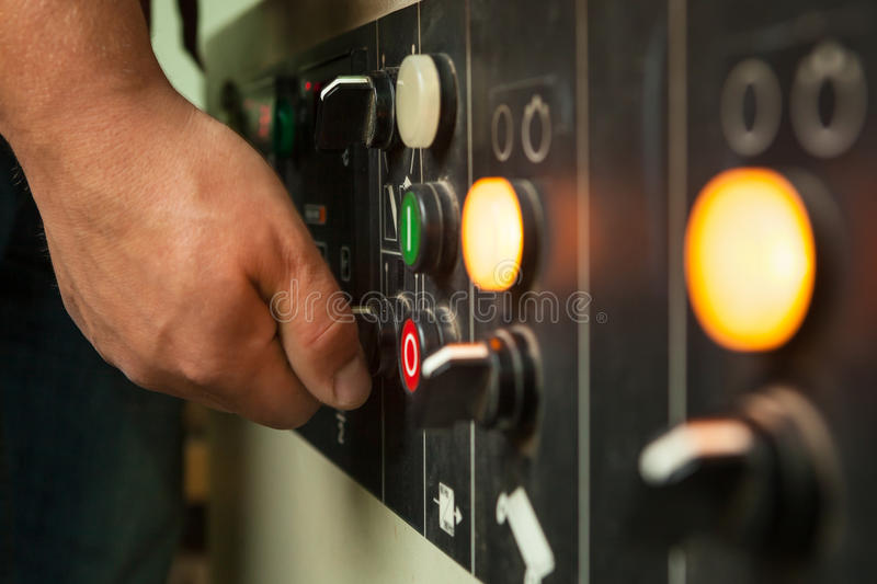 Male hand operating switches and buttons. Male hand operating switches and buttons on control panel stock photos