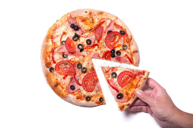 Male hand picking pizza slice. Male hand picking tasty pizza slice, on white background royalty free stock photos