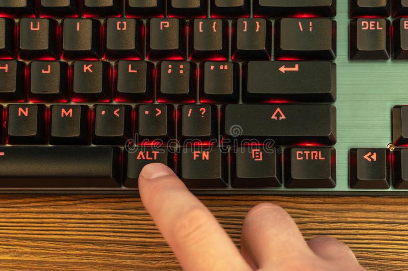 Male hand presses the alt key royalty free stock images
