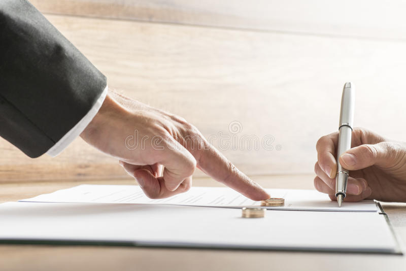 Male hand pushing a wedding ring over to a female hand about to royalty free stock photo