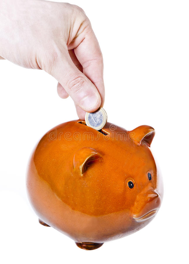 Download Male Hand Putting Coin Into A Piggy Bank Stock Image - Image: 30017125