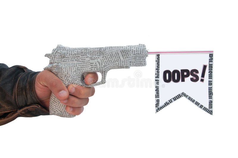 Male hand with shoting newspaper pistol and flag. On white background. oops fake stock photography