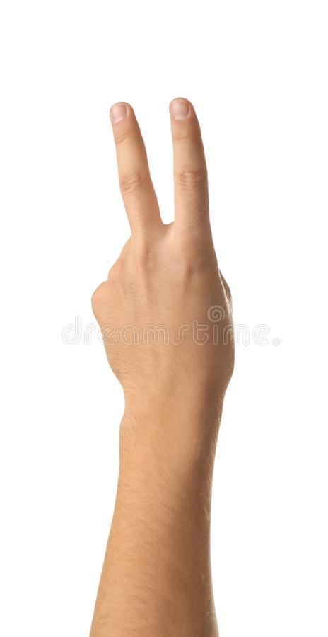 Male hand showing two fingers on white background stock image