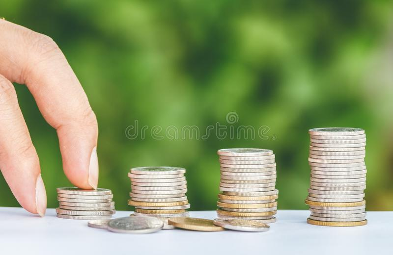 Male hand steps on money coin like stack growing business royalty free stock photos