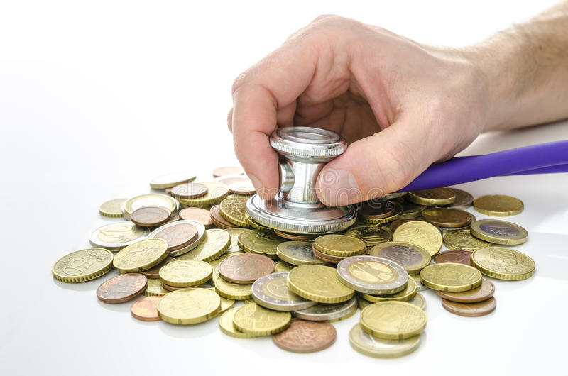 Male hand with stethoscope over Euro money royalty free stock image