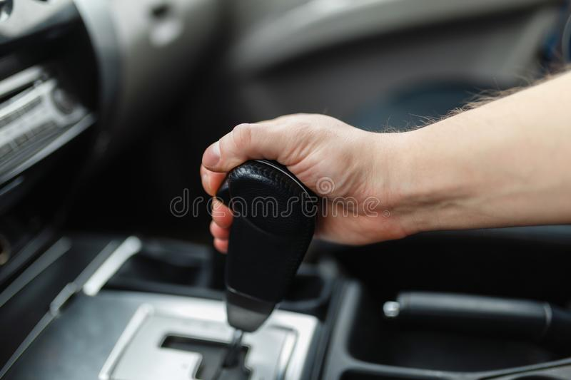 The male hand switches the transmission royalty free stock photography