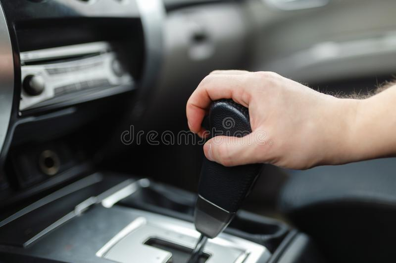 The male hand and switches the transmission royalty free stock photography
