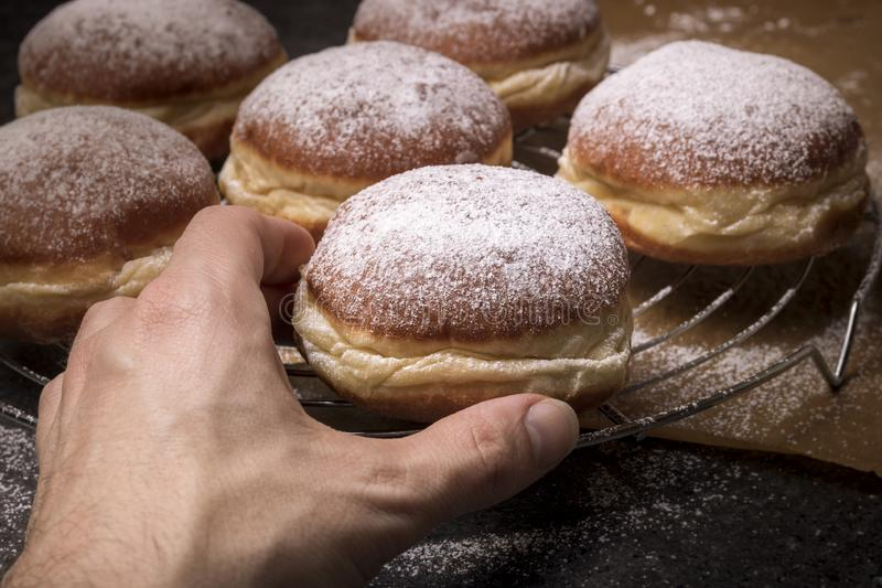 Male hand taking tasty donut royalty free stock photography