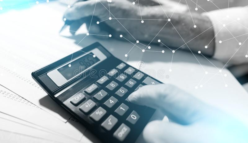 Hand using calculator, accounting concept; multiple exposure royalty free stock photography