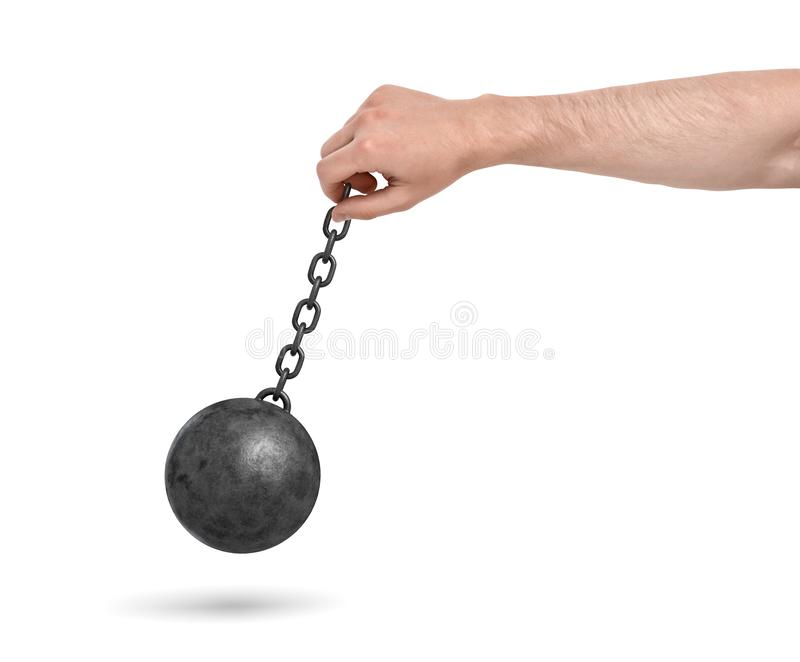 A male hand on a white background holding a black metal chain with a wrecking ball swinging on it. stock image