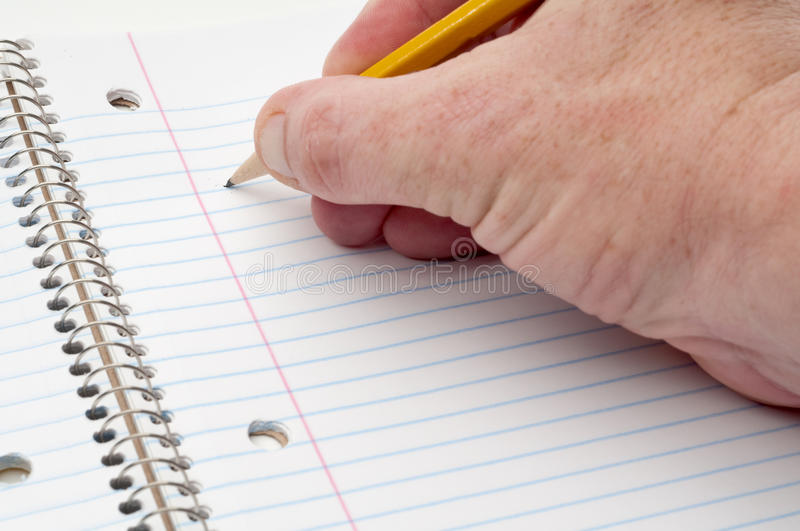 Download A Male Hand Writing On Lined Notepaper Stock Image - Image: 10921785